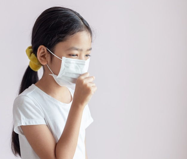 Portrait of children wearing sanitary masks and coughs