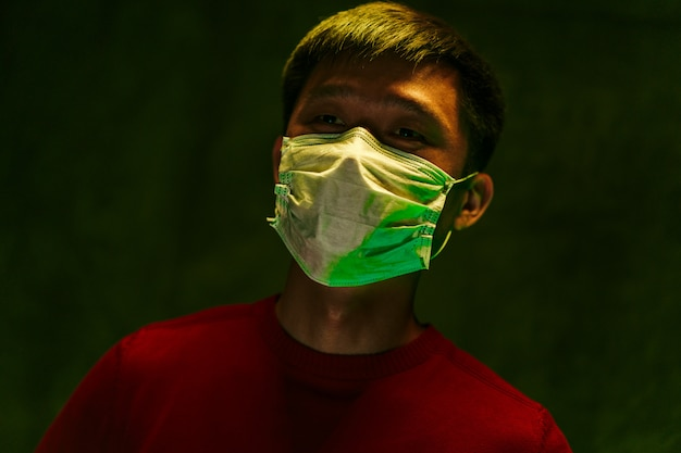 Portrait of a chinese man wearing medical protective mask. coronavirus protection concept
