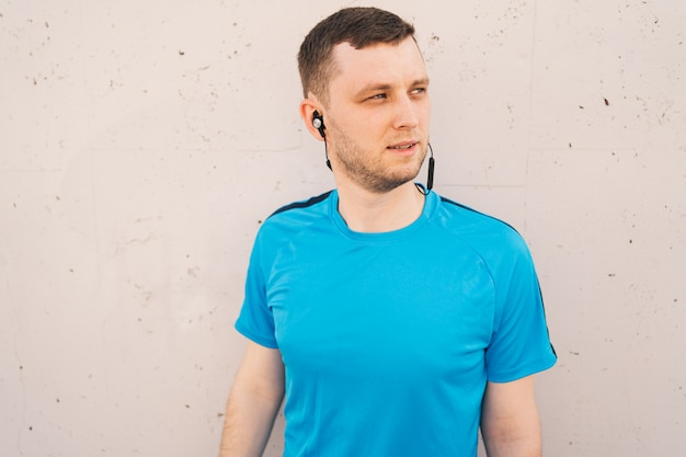 Portrait of city runner with black headphones