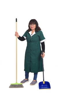 Portrait of a cleaning woman with broom and dustpan on white