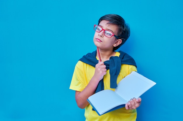 A portrait of a clever and studious boy with red glasses