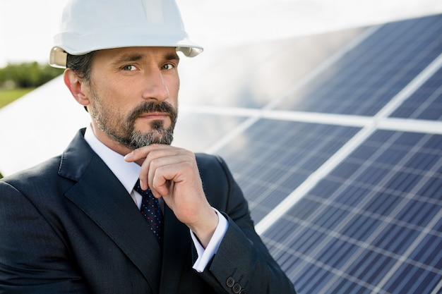 Portrait of client in white helmet at solar power station.