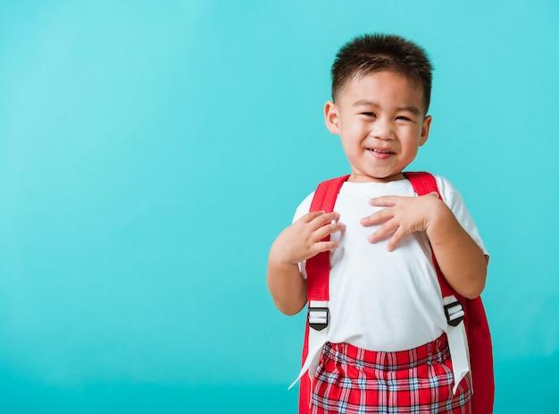 Portrait closeup happy asian cute little child boy in uniform smiling