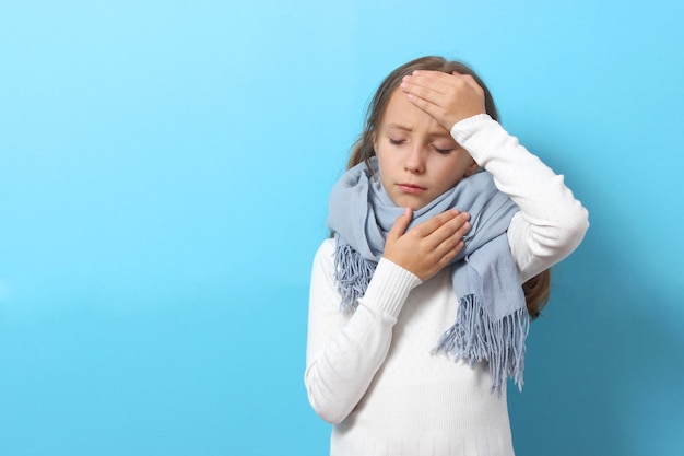 Portrait of a cold girl on a colored background