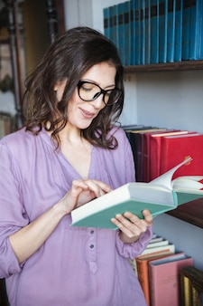 Portrait of a concentrated mature woman reading book