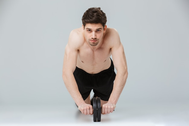 Portrait of a concentrated young half naked sportsman