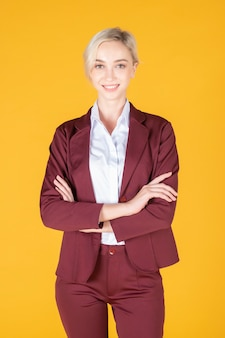 Portrait of confidence caucasian business woman on yellow background