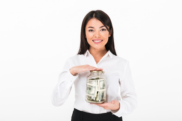 Portrait of a confident asian businesswoman holding jar