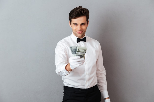 Portrait of a confident attractive male waiter