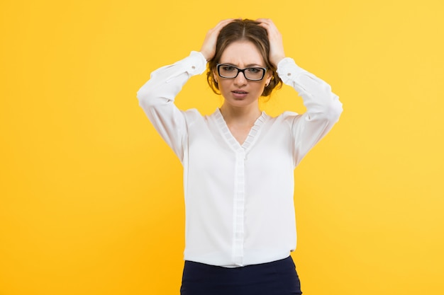 Portrait of confident beautiful young business woman holding head with her hands