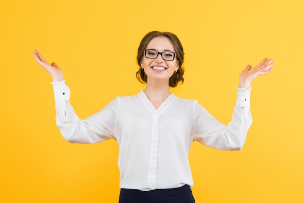 Portrait of confident beautiful young smiling happy business woman on yellow