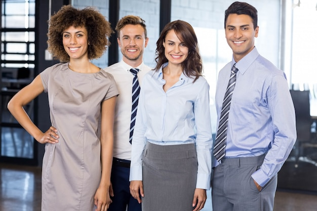 Portrait of confident business  team smiling and standing together in office