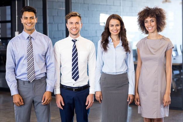 Portrait of confident business  team standing in office