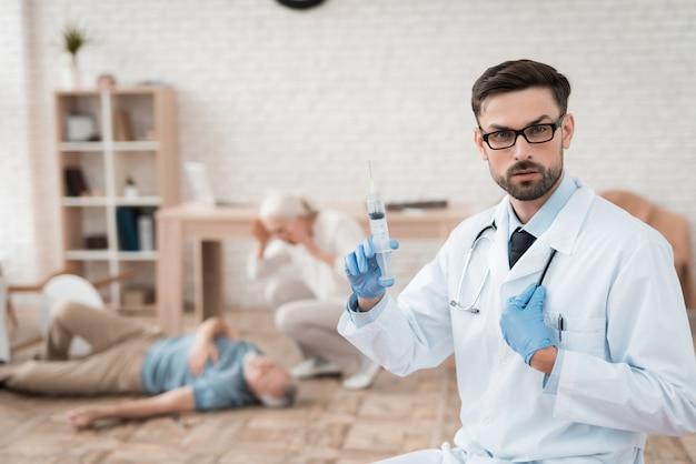 Portrait of confident doctor with syringe of nitroglycerin.