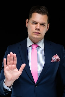 Portrait of confident handsome businessman stretch his hand forward