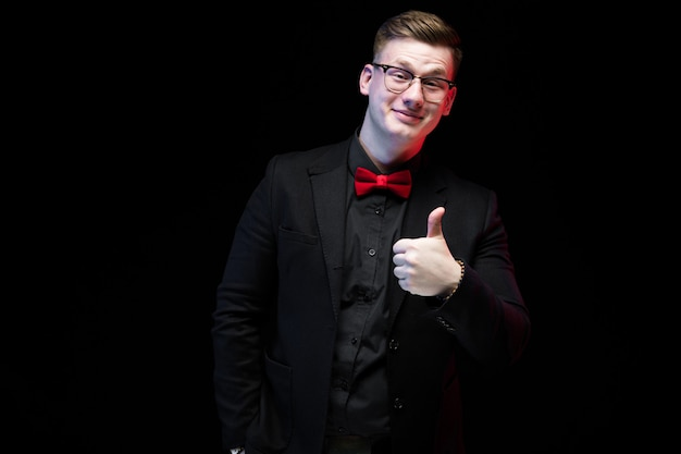 Portrait of confident handsome excited happy elegant responsible businessman with thumb up