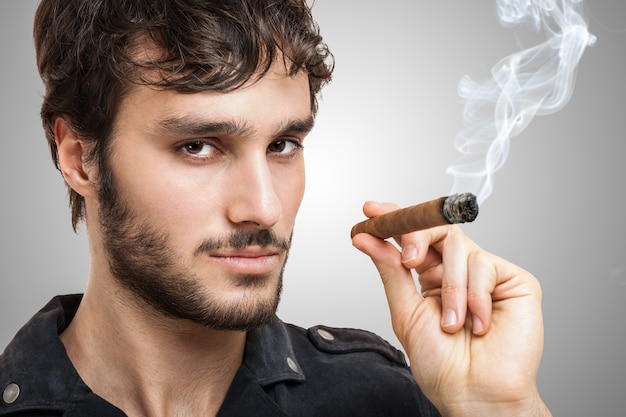 Portrait of a confident man smiking a cigar