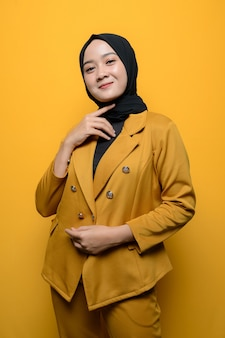 Portrait of a confident muslim woman on yellow background