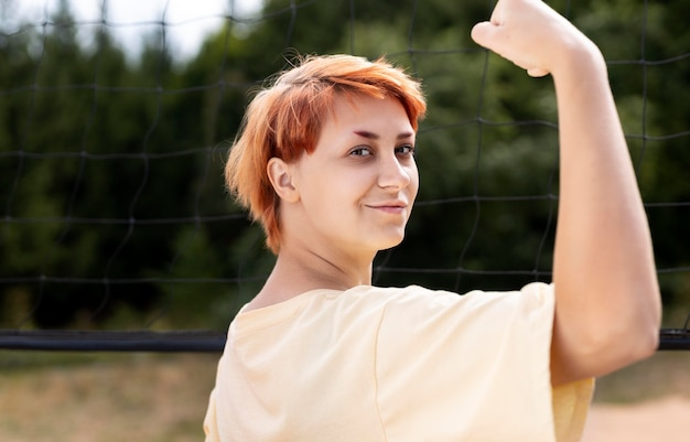 Portrait of confident redhead girl outdoors