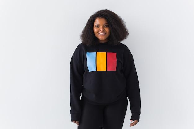 Portrait of confident sexy black woman in stylish sweatshirt