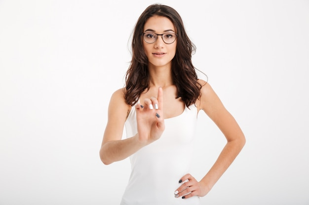 Portrait of a confident woman dressed in tank-top