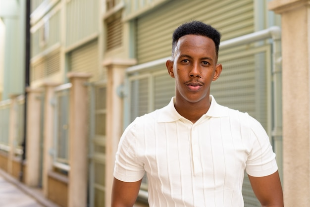 Portrait of confident young african businessman wearing casual clothes