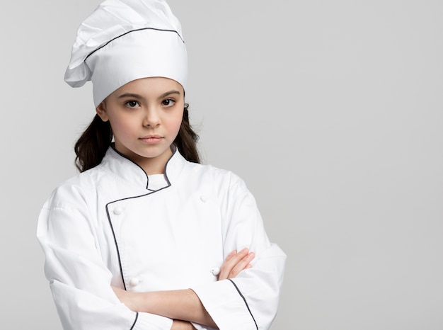 Portrait of confident young chef posing