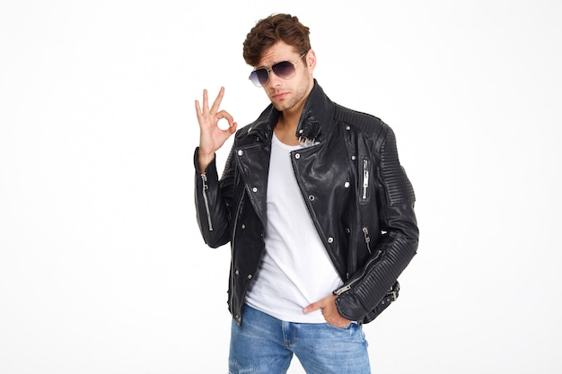 Portrait of a confident young man in a leather jacket
