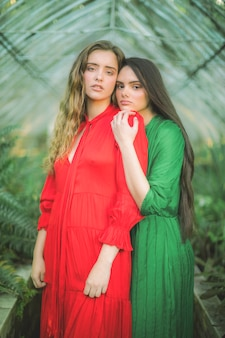 Portrait of contrasted coloured dresses