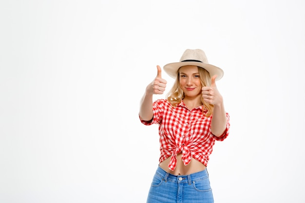 Portrait of country woman showing okay on white.