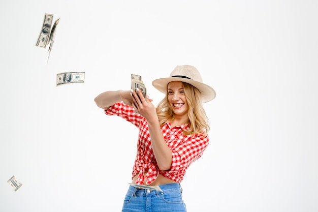 Portrait of country woman throwing money on white.