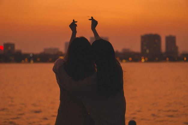 Portrait of a couple and a beautiful sunset