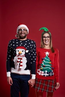 Portrait of couple in christmas clothes isolated