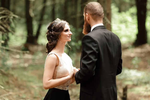 Portrait of a couple in love on a forest background