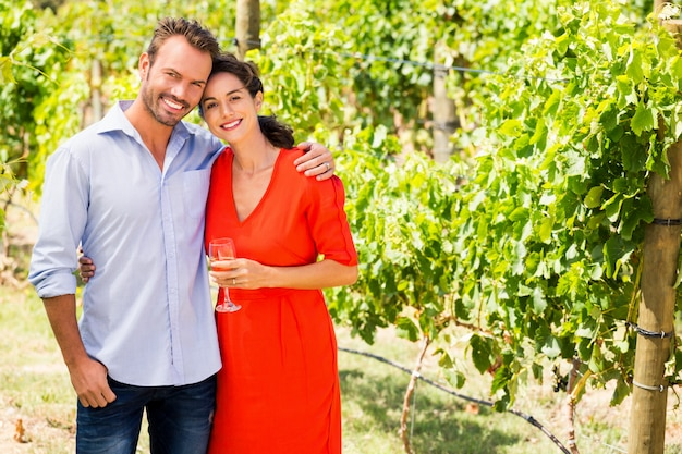 Portrait of couple standing at vineyard