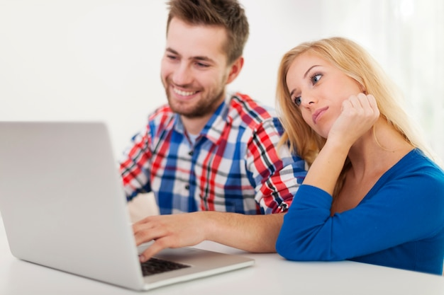 Portrait of couple with contemporary laptop