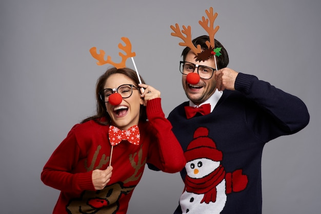 Portrait of couple with funny reindeer gadgets