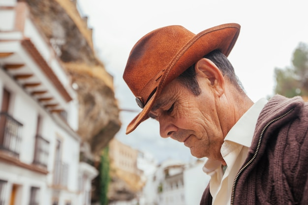 Portrait of a cowboy on a picturesque village in the south of spain