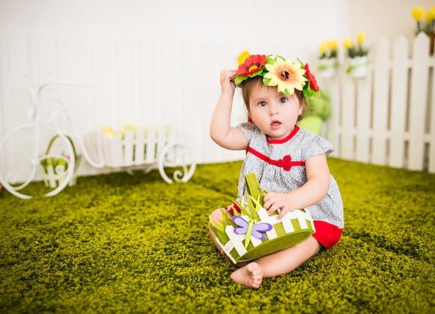 Portrait of curious little barefoot girl in dress