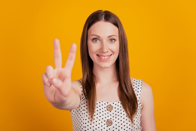 Portrait of cute adorable lady count fingers show number four on yellow background