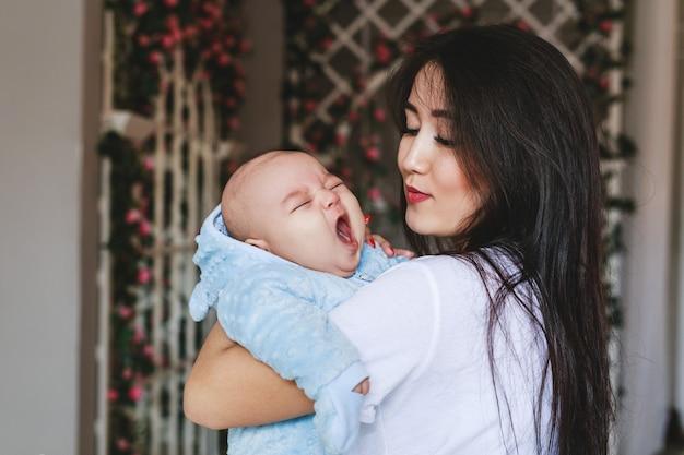 Portrait of a cute asian baby boy yawning.