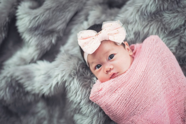 Portrait of cute baby on the bed