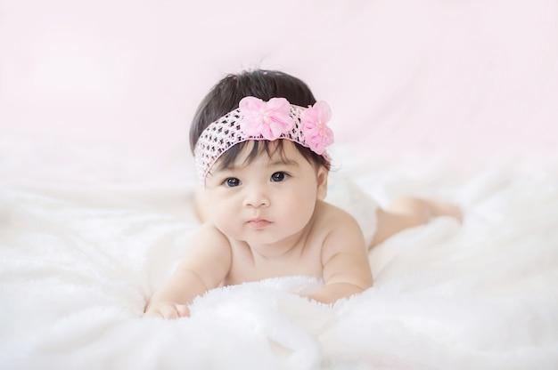 Portrait of cute baby girl on blanket of fur