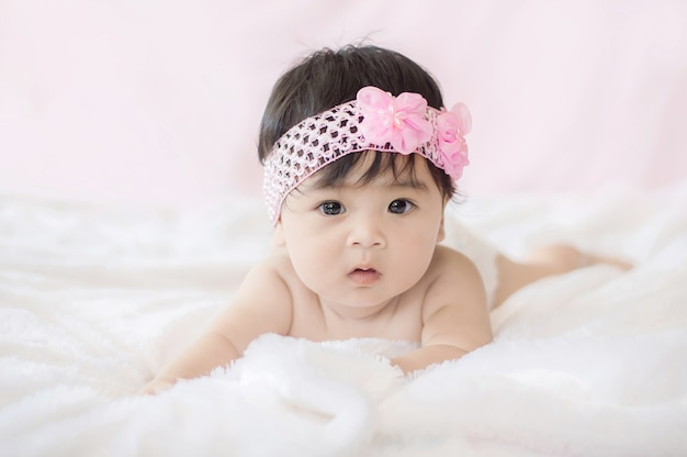 Portrait of cute baby girl on blanket of fur