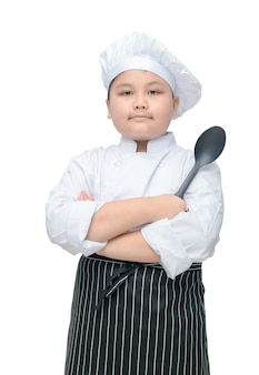 Portrait of cute boy chef hold spoon with cook hat