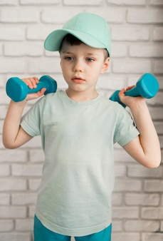 Portrait of cute boy exercising at home