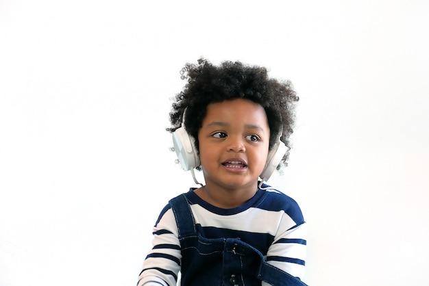 Portrait of a cute boy wearing earphones