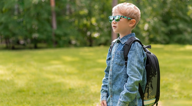 Portrait of cute boy with backpack. school. first grader