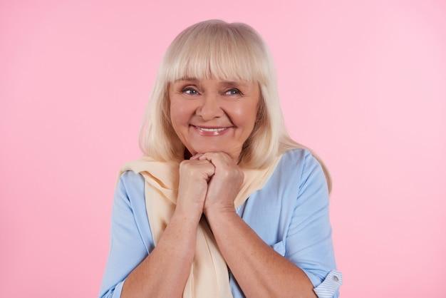 Portrait of cute elderly woman who is smiling.
