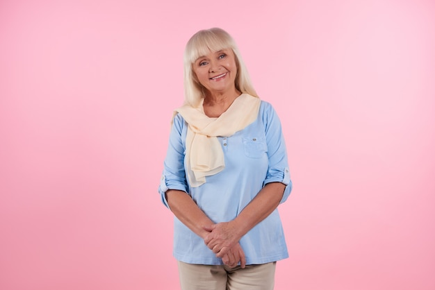 Portrait of cute elderly woman who is smiling